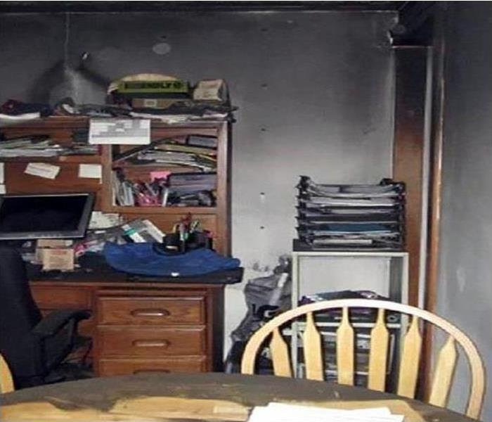 a room with book shelves that had soot and smoke damage after a fire